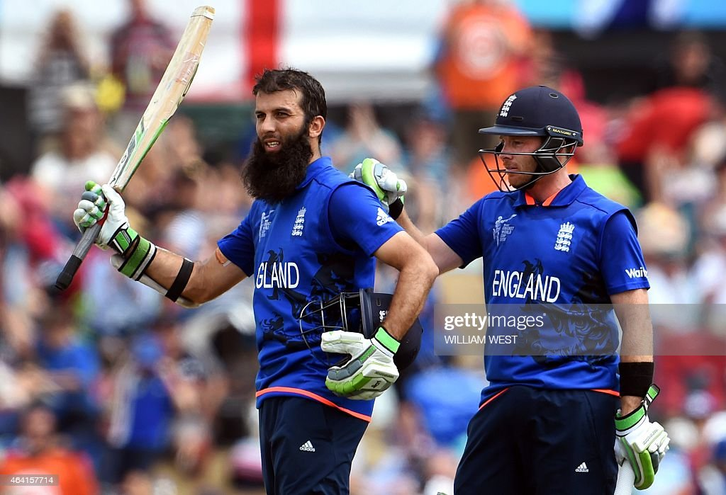 England batsman Moeen Ali acknowledges the applause after scoring his century against Scotland as teammate Ian Bell pats him on the back during their...