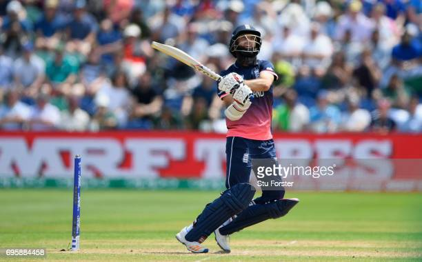 England batsman Moeen Ali hits out only to be caught during the ICC Champions Trophy semi final between England and Pakistan at SWALEC Stadium on...