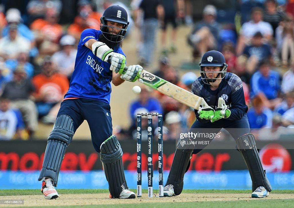 England batsman Moeen Ali pulls a ball for six as Scotland wicketkeeper Matt Cross looks on during their 2015 Cricket World Cup Group A match in...