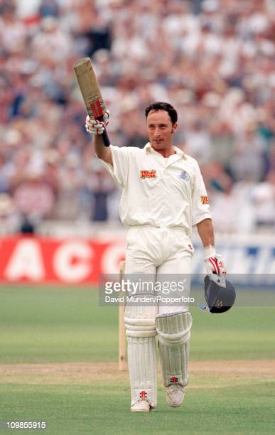 England batsman Nasser Hussain acknowledges the crowd after completing his century in the first innings of the 1st Test match between England and...