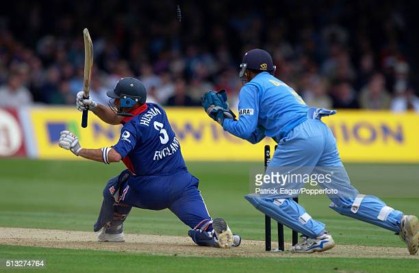 England batsman Nasser Hussain is stumped by Rahul Dravid for 54 during the NatWest One Day International between England and India at Lord's London...