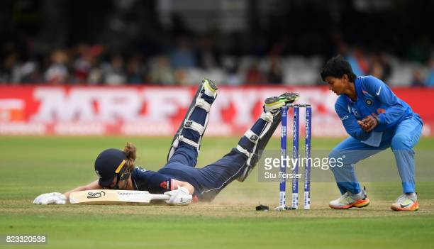 England batsman Natalie Sciver dives for her ground as India bowler Deepti Sharma attempts to run her out during the ICC Women's World Cup 2017 Final...