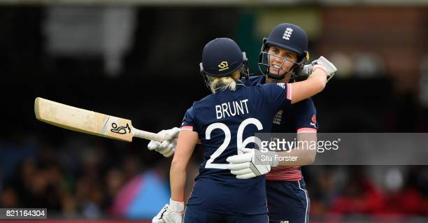 England batsman Natalie Sciver reaches her 50 and is congratulated by Kathryn Brunt during the ICC Women's World Cup 2017 Final between England and...