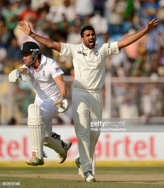 England batsman Nick Compton takes his first run in Test cricket on his debut for England past India's Zaheer Khan during the 1st Test match between...