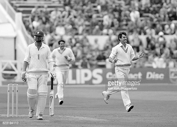 England batsman Phil Edmonds walks off as New Zealand bowler Richard Hadlee celebrates during the 2nd Test match between England and New Zealand at...