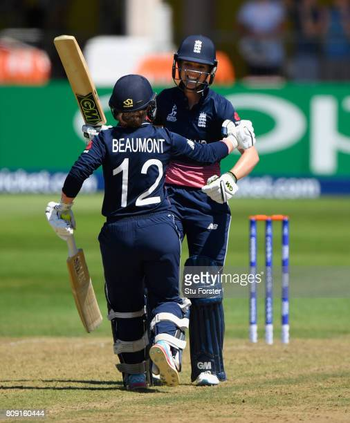 England batsman Sarah Taylor celebrates her century with fellow century maker Tammy Beaumont during the ICC Women's World Cup 2017 match between...
