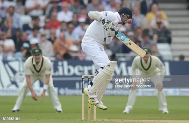 England batsman Stuart Broad is hit by a shortpitchd delivery from Australia's James Pattinson during the 1st Test match between England and...