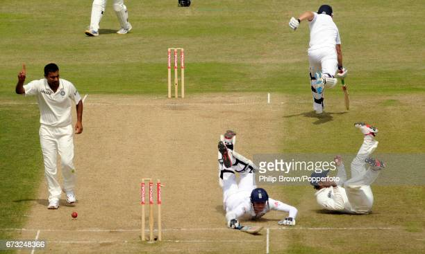 England batsman Stuart Broad is run out by India's substitute fielder Wriddhiman Saha as Praveen Kumar reacts during the 2nd Test match against India...