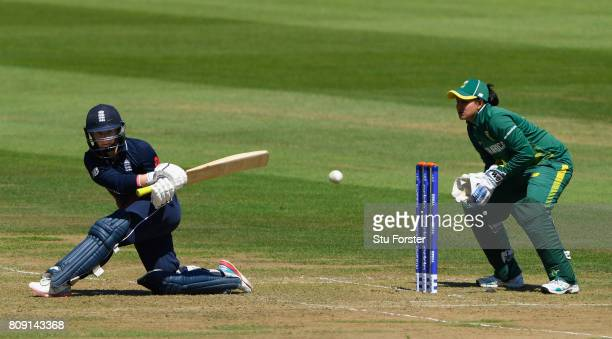 England batsman Tammy Beaumont hits out watched by wicketkeeper Chetty during the ICC Women's World Cup 2017 match between England and South Africa...
