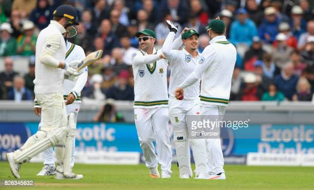 England batsman Tom Westley is caught behind by Quinton de Kock who is congratulated by team mates during day one of the 4th Investec Test match...