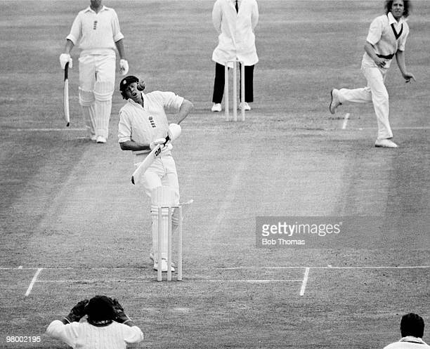 England batsman Tony Greig narrowly avoids being hit in the face by a ball bowled by Australia's Jeff Thomson during the 2nd Test match at Old...