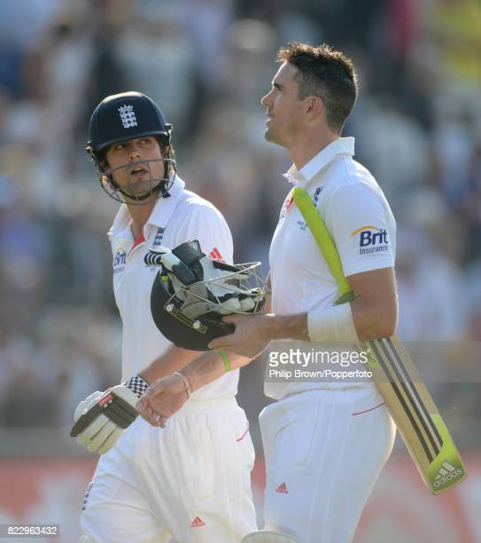 England batsmen Alastair Cook and Kevin Pietersen leave the field at the end of the day's play in the 1st Test match between England and Australia at...