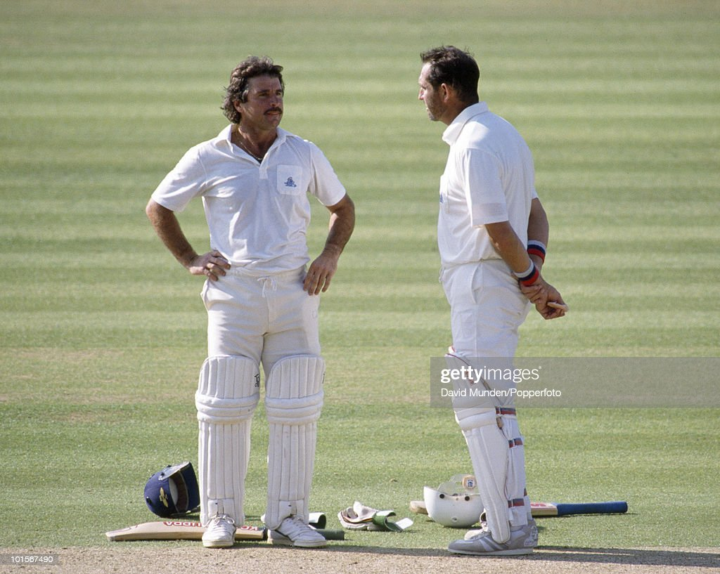 England batsmen Allan Lamb (left) and Graham Gooch take a break during their long partnership in England's first innings of the 1st Test Match between England and India at Lord's Cricket Ground in London, 26th July 1990. Lamb scored 139 and Gooch reached 333 before he was eventually dismissed towards the end of the second day. England won by 247 runs.