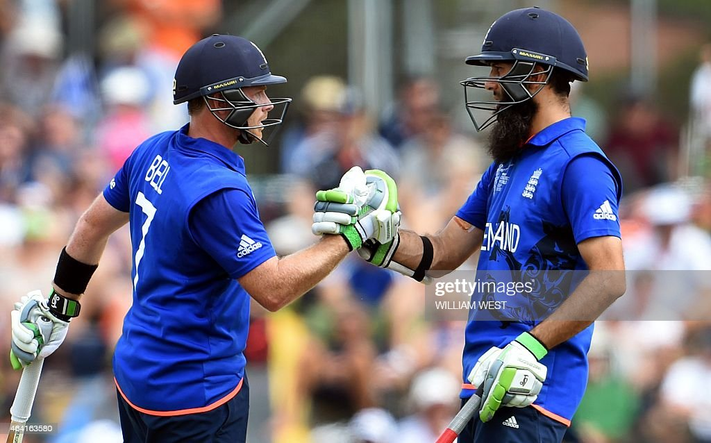 England batsmen Ian Bell and Moeen Ali congratulate each other in their record opening partnership against Scotland during their 2015 Cricket World...