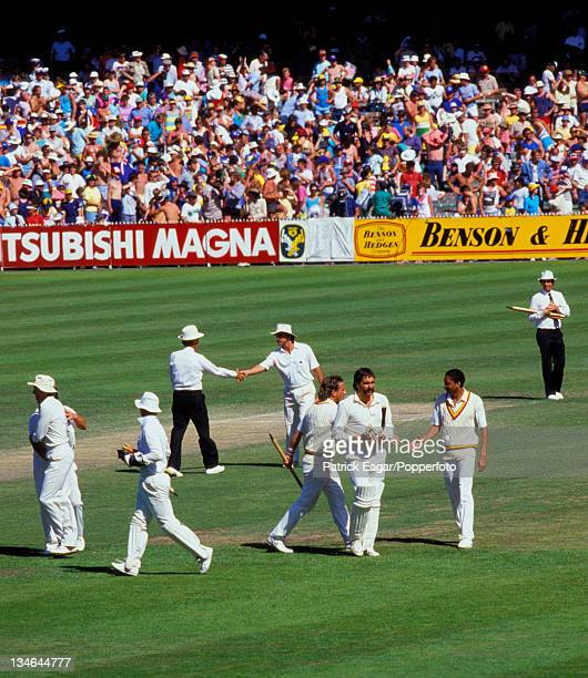 England beat Australia and retain the Ashes Gower Richards umpire Lamb Botham Hughes DeFreitas and umpire Australia v England 4th Test Melbourne...