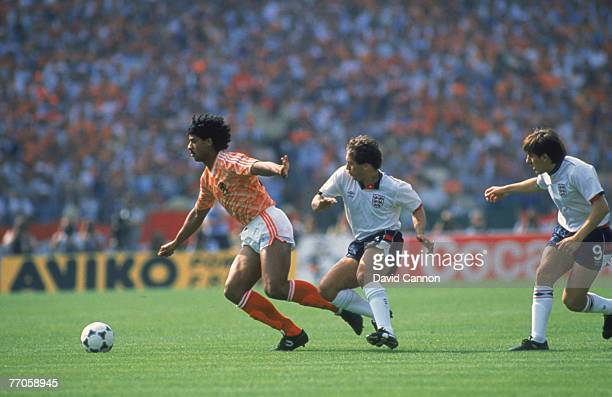 England beats Holland 01 during the European Championships in West Germany 1988 Dutch player Frank Rijkaard is tracked by England's Kenny Sansom and...
