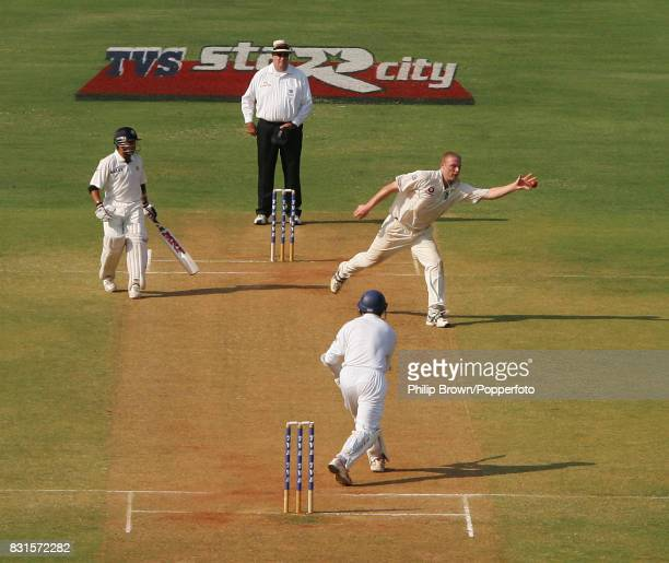 England bowler Andrew Flintoff fields off his own bowling from India's Rahul Dravid during the 3rd Test match between India and England at the...