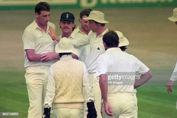 England bowler Angus Fraser is congratulated after getting his team off to a strong start against India