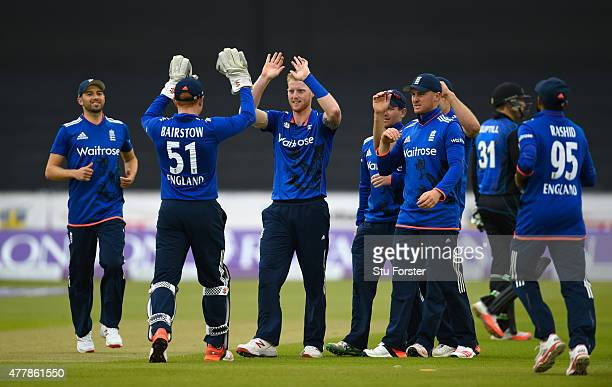England bowler Ben Stokes celebrates with team mates after dismissing New Zealand batsman Martin Guptill during the 5th Royal London One day...