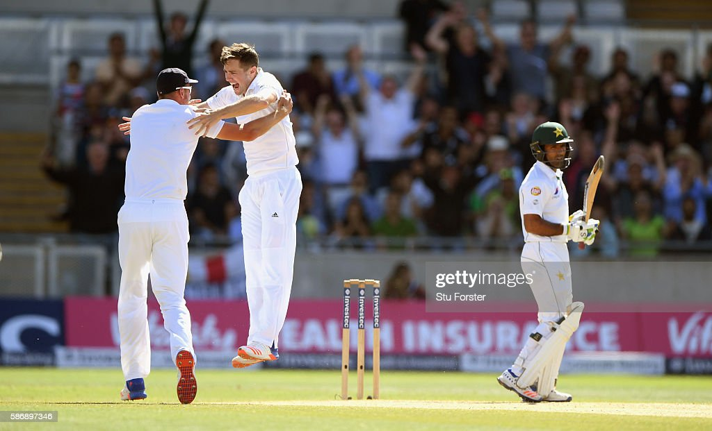 England bowler Chris Woakes celebrates with Stuart Broad after dismissing Asad Shafiq during day 5 of the 3rd Investec Test match between England and Pakistan at Edgbaston on August 7, 2016 in Birmingham, England.