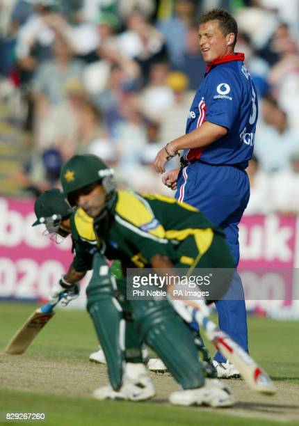 England bowler Darren Gough looks on as the Pakistani openers Imran Nazir and Mohammad Hafeez make runs during the first NatWest Challenge match at...