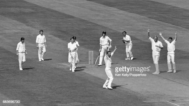 England bowler Derek Underwood celebrates the wicket of Australian batsman John Inverarity caught by England captain Ray Illingworth for a firstball...