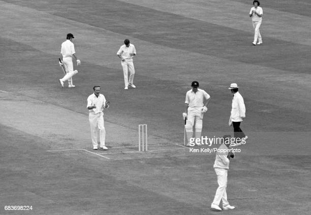 England bowler Derek Underwood celebrates the wicket of Australian batsman Greg Chappell caught by Basil D'Oliveira for 13 during the 4th Test match...
