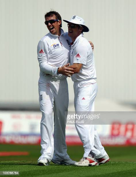 England bowler Graeme Swann celebrates with Andrew Strauss after bowling out Pakistan batsman Azhar Ali for 19 runs on the third day of the second...