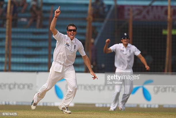 England bowler Graeme Swann celebrates with captain Alastair Cook after taking the wicket of Bangladesh batsman Aftab Ahmed during day two of the 1st...