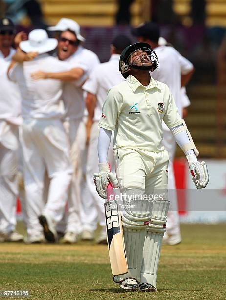 England bowler Graeme Swann celebrates with team mates after taking the wicket of Bangladesh batsman Mushfiqur Rahim for 95 runs during day five of...