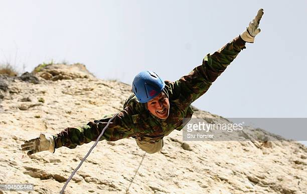 England bowler Graeme Swann flys head first down the rockface during an abseiling excercise at the England Cricket squad Pre Ashes Training Camp on...