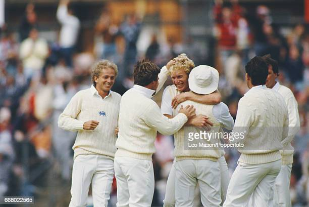 England bowler Graham Dilley is congratulated by teammates David Gower Mike Gatting and others during play against India in the Texaco Trophy 1st one...