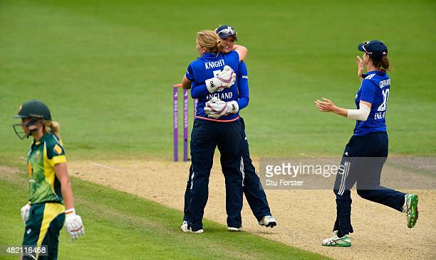England bowler Heather Knight is congratulated by Sarah Taylor after dismissing Australia batsman Alyssa Healy during the 3rd Royal London ODI of the...