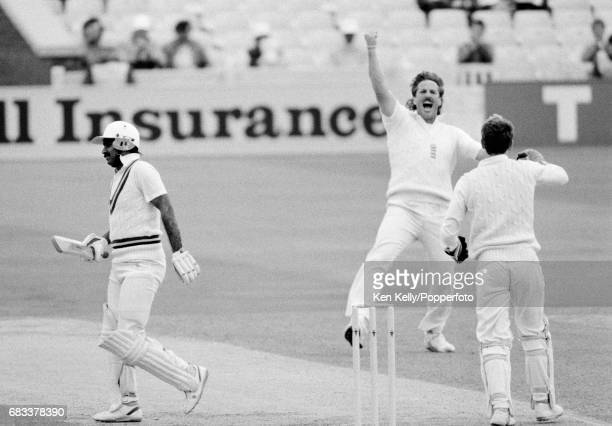 England bowler Ian Botham celebrates the wicket of Pakistan batsman Javed Miandad caught by England wicketkeeper Bruce French for 21 during the 1st...