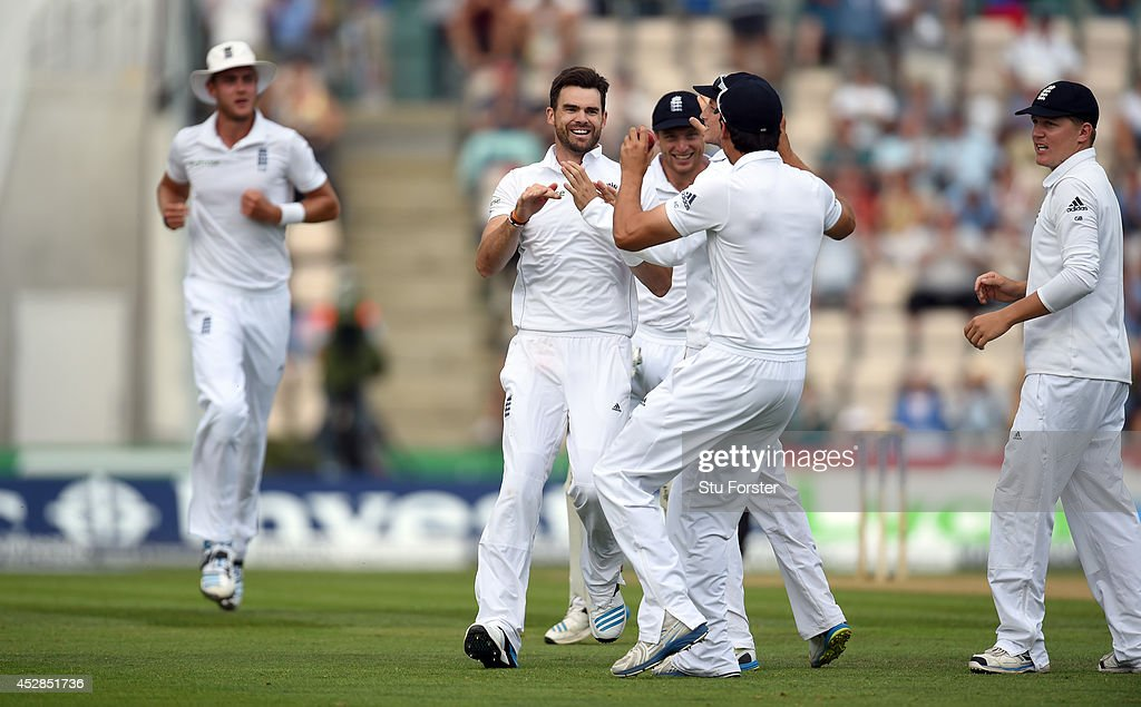 England bowler <a gi-track='captionPersonalityLinkClicked' href=/galleries/search?phrase=James+Anderson+-+Cricket+Player&family=editorial&specificpeople=6920305 ng-click='$event.stopPropagation()'>James Anderson</a> congratulates captain <a gi-track='captionPersonalityLinkClicked' href=/galleries/search?phrase=Alastair+Cook+-+Cricket+Player&family=editorial&specificpeople=571475 ng-click='$event.stopPropagation()'>Alastair Cook</a> after he had caught India batsman Shikhar Dhawan during day two of the 3rd Investec Test at Ageas Bowl on July 28, 2014 in Southampton, England.