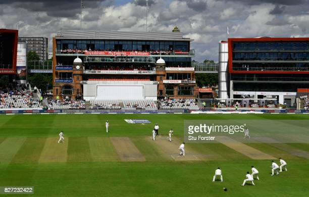 England bowler James Anderson takes the wicket of Heino Kuhn caught by Alastair Cook for 11 runs infront of the James Anderson end of the ground...