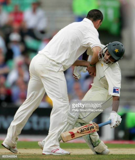 England bowler Kevin Pietersen collides with Pakistan batsman Mohammad Hafeez in trying to field the ball during the 4th Test match between England...