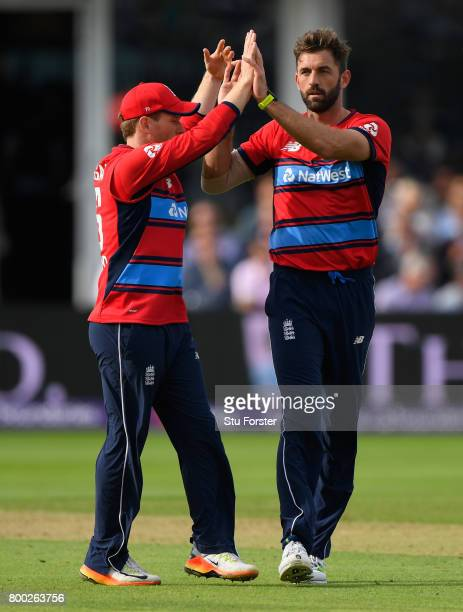 England bowler Liam Plunkett and Eoin Morgan celebrate a wicket during the 2nd NatWest T20 International between England and South Africa at The...