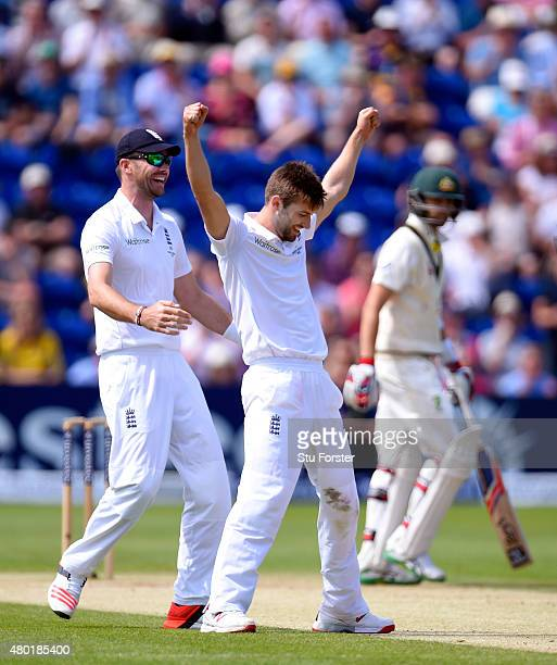 England bowler Mark Wood and James Anderson celebrate after Wood dismissed Nathan Lyon lbw during day three of the 1st Investec Ashes Test match...
