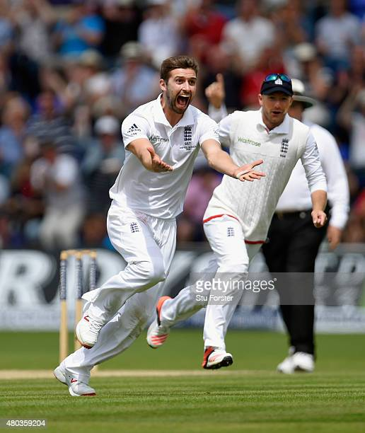 England bowler Mark Wood celebrates after dismissing Australia batsman Adam Voges during day four of the 1st Investec Ashes Test match between...