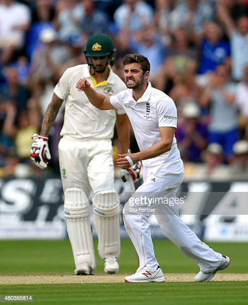 England bowler Mark Wood celebrates after dismissing Australia batsman Shane Watson during day four of the 1st Investec Ashes Test match between...