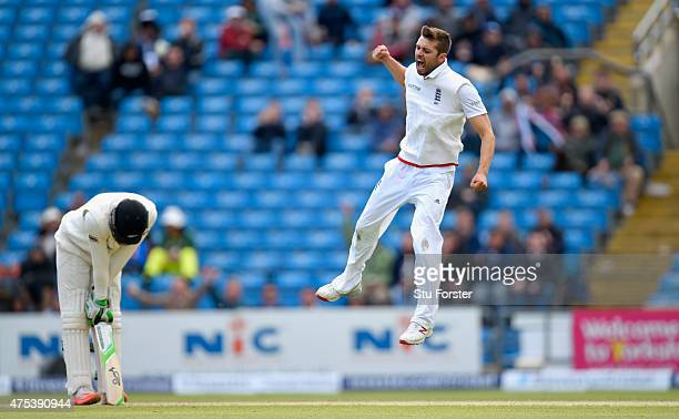 England bowler Mark Wood celebrates after dismissing New Zealand batsman Martin Guptill during day three of the 2nd Investec test match between...