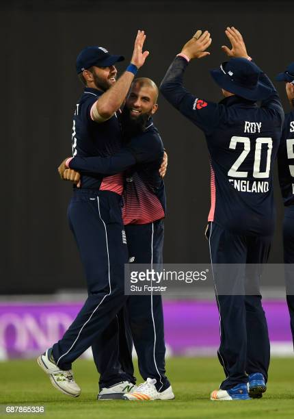 England bowler Moeen Ali celebrates with Liam Plunkett after the pair combined to dismiss South Africa batsman AB de Villiers during the 1st Royal...