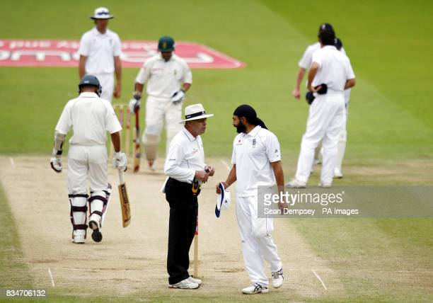 England bowler Monty Panaser has words with umpire Daryl Harper during The First npower Test match at Lord's Cricket Ground London