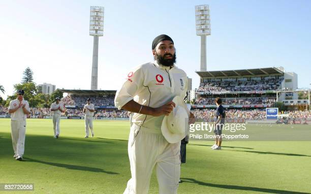 England bowler Monty Panesar is applauded off the field after taking five wickets in Australia's first innings of the 3rd Test match between...