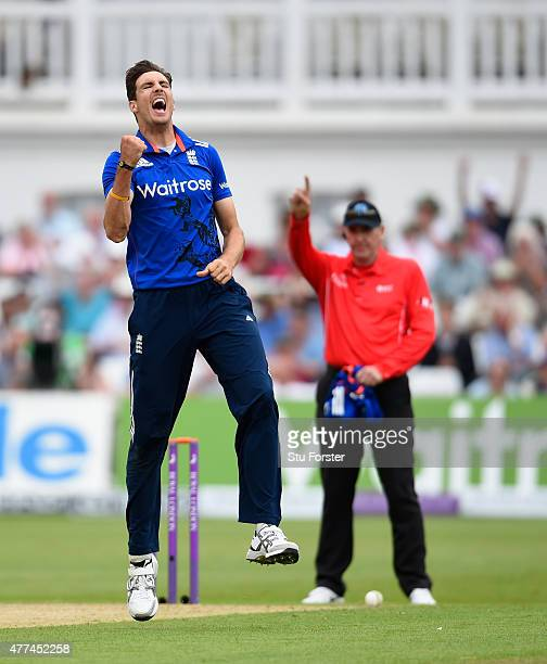 England bowler Steven Finn celebrates after dismissing Ross Taylor of New Zealand as umpire Rob Bailey raises the finger during the 4th ODI Royal...