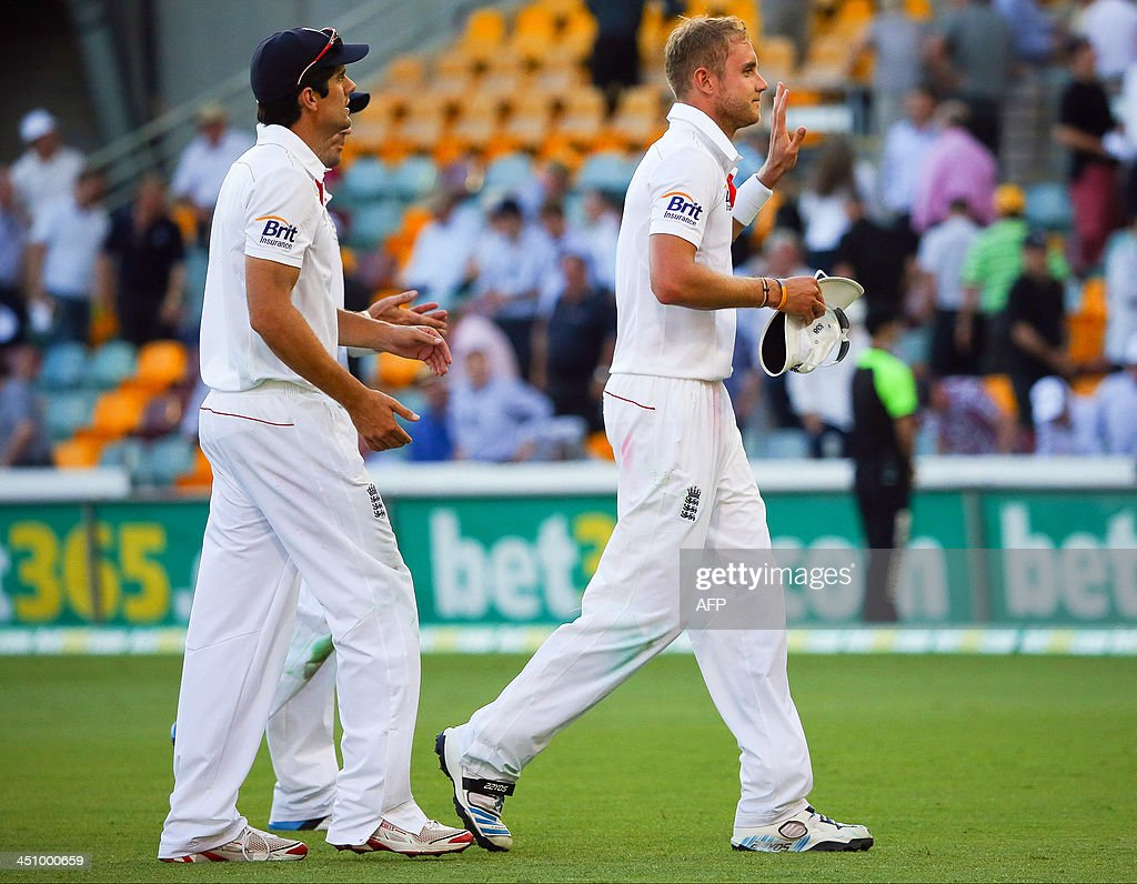 England bowler Stuart Broad (R) acknowledges the crowd after his five-wicket haul following play on day one of the first Ashes cricket Test match between England and Australia at the Gabba Cricket Ground in Brisbane on November 21, 2013. AFP PHOTO / Patrick Hamilton IMAGE