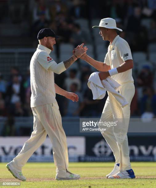 England bowler Stuart Broad celebrates after Ben Stokes catches South Africa's Kagiso Rabada off his bowling during play on day 2 of the fourth Test...