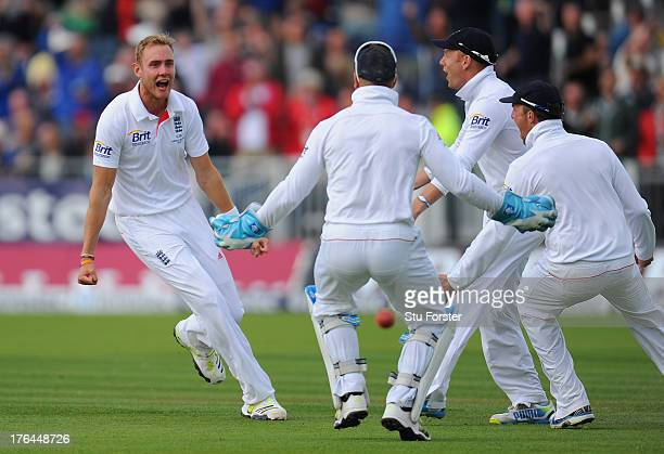 England bowler Stuart Broad celebrates with team mates after bowling Michael Clarke during day four of 4th Investec Ashes Test match between England...