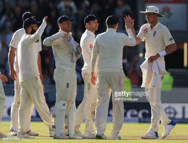 England bowler Stuart Broad celebrates with teammates after taking the wicket of South Africa's Kagiso Rabada during play on day 2 of the fourth Test...